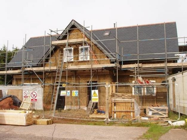 A two storey semi-detached loadbearing straw house.